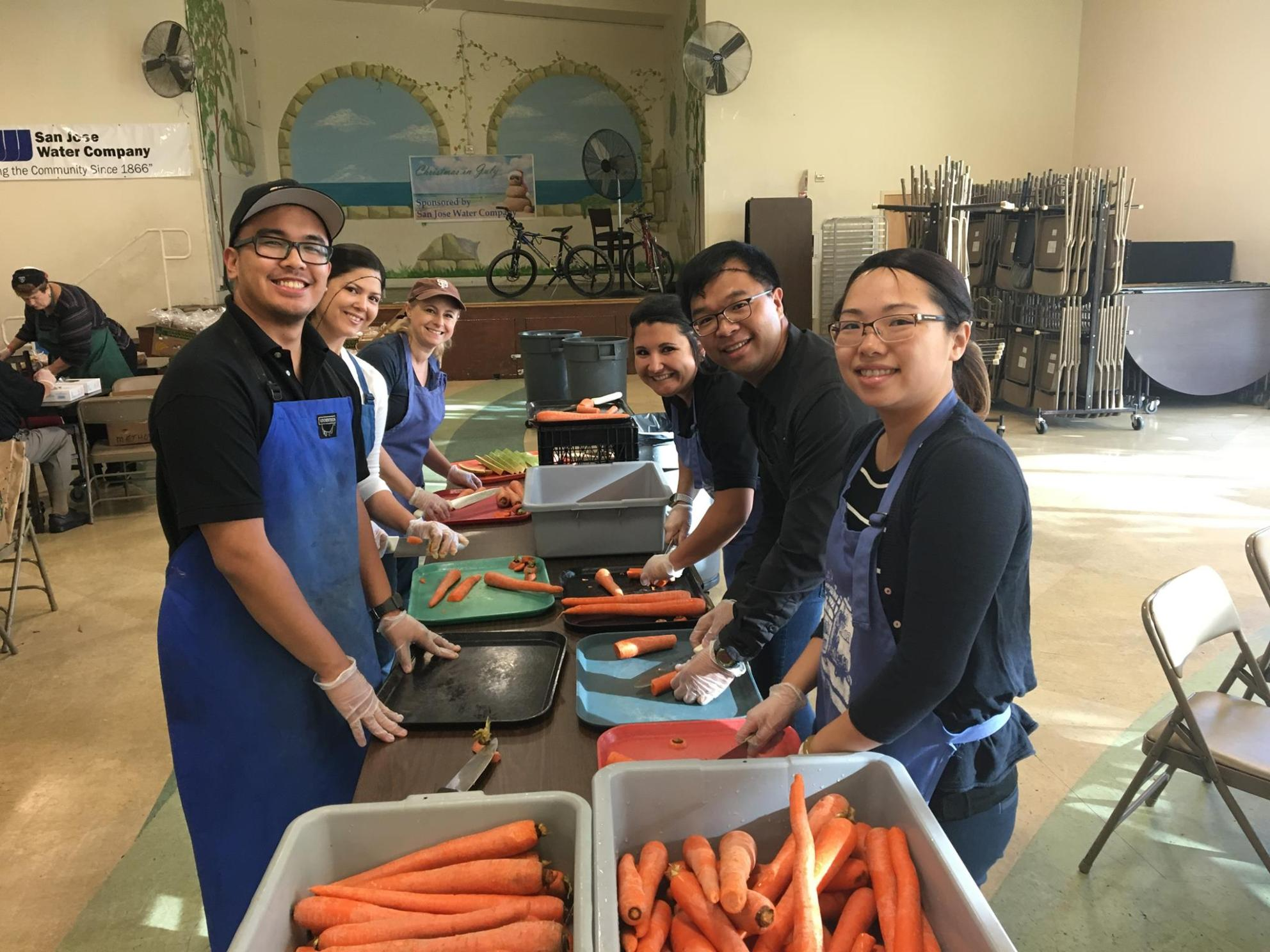 Team members serving healthy food
