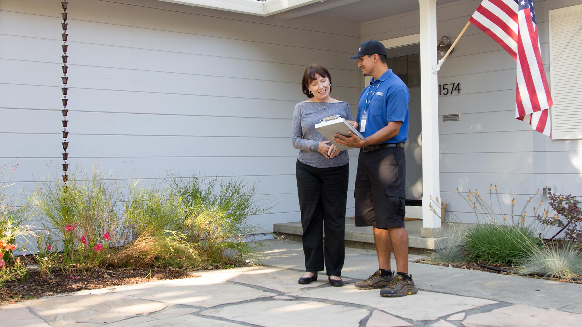 San Jose Water Worker and Customer talk outside a home