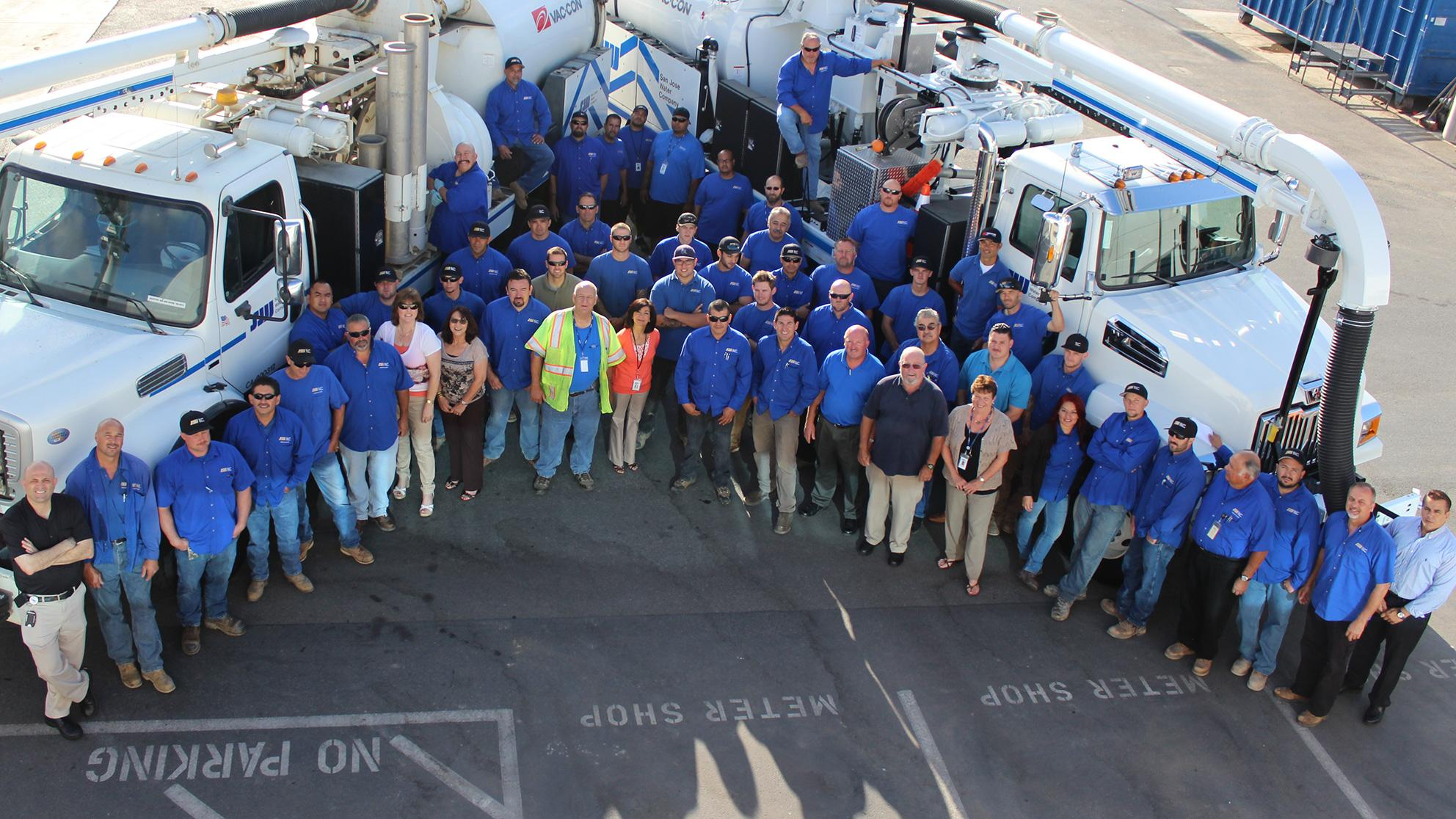 Diverse San Jose Water employees stand outside together