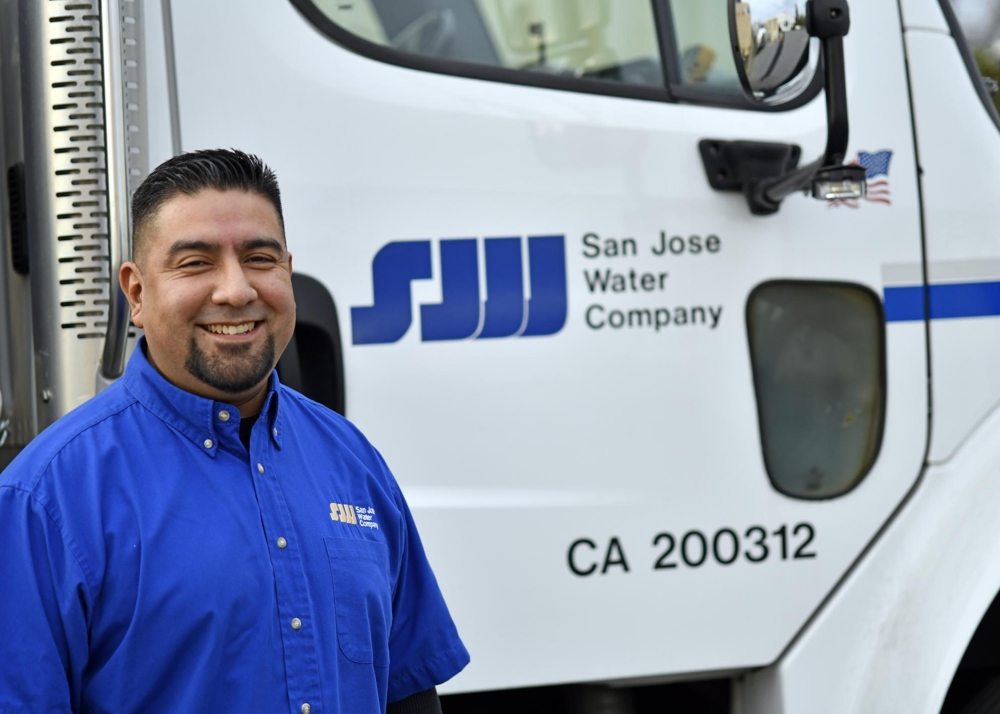SJW employee in front of SJW truck