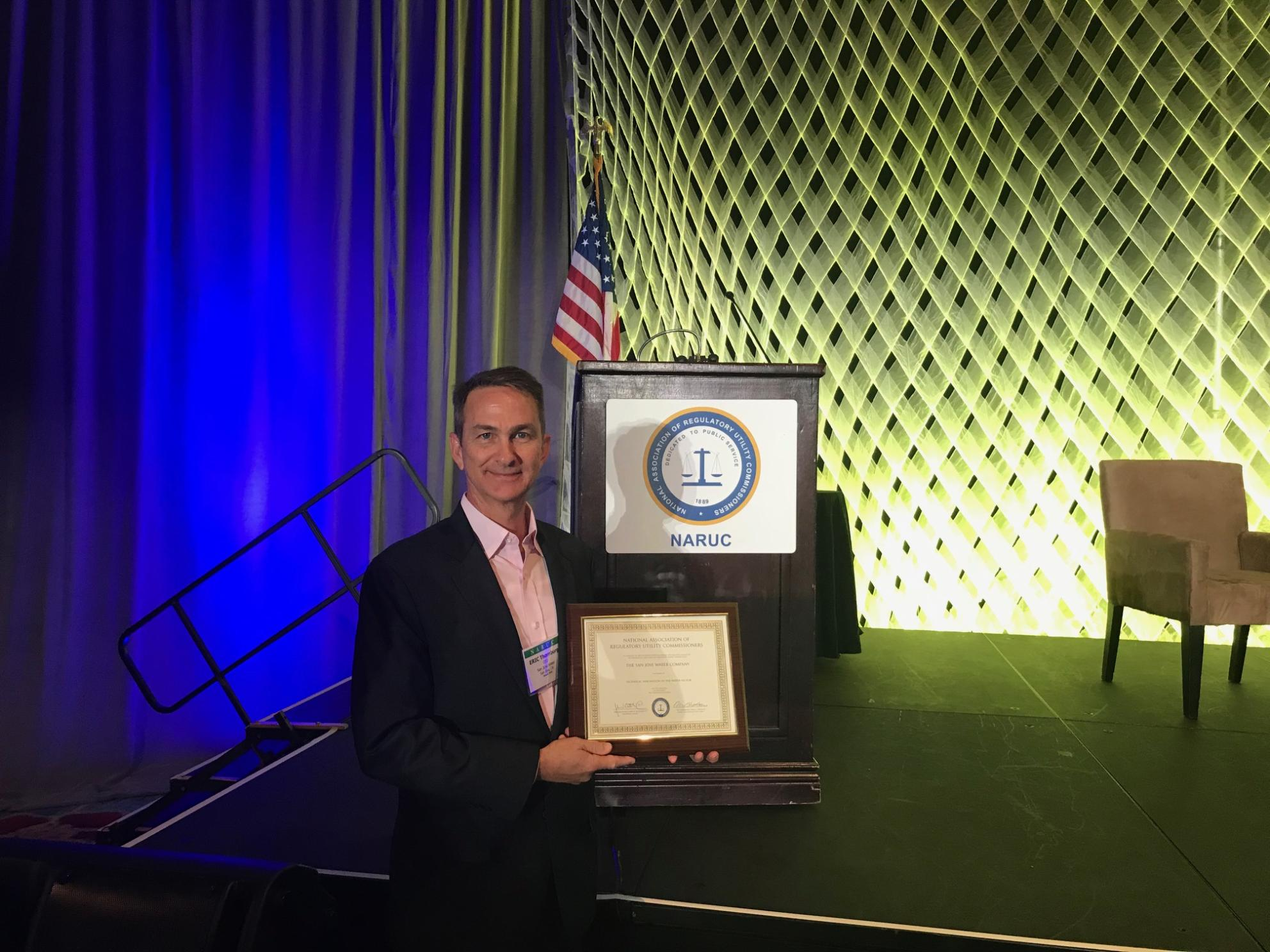 San Jose Water CEO Eric W. Thornburg holding NARUC Award