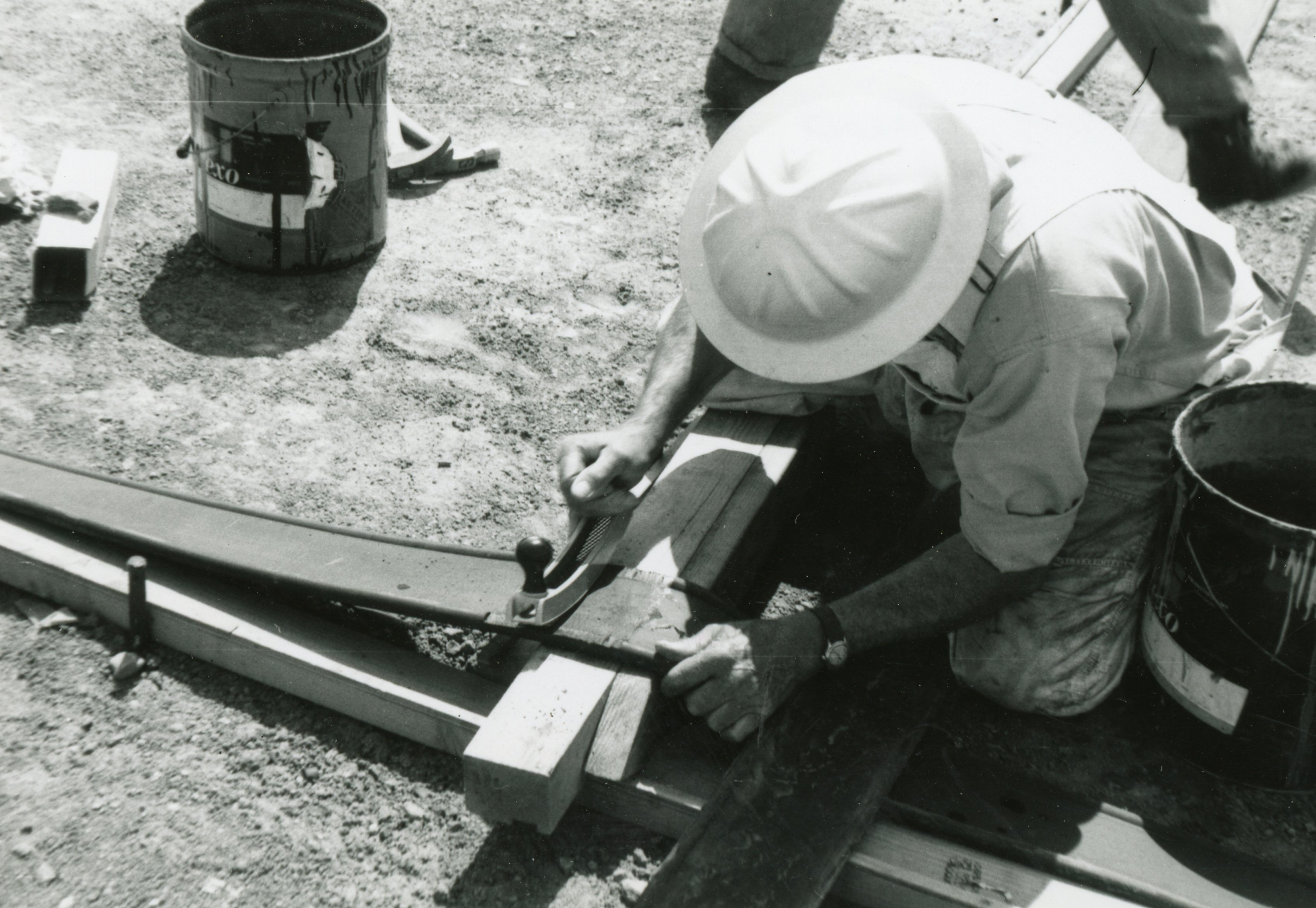 Columbine Historical Image 3 - black and white photo of a workers cutting material