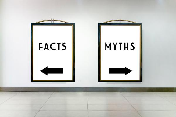"Two signs on a wall, one says ""Facts"" and points to the left, the other says ""Myths"" and points to the right"