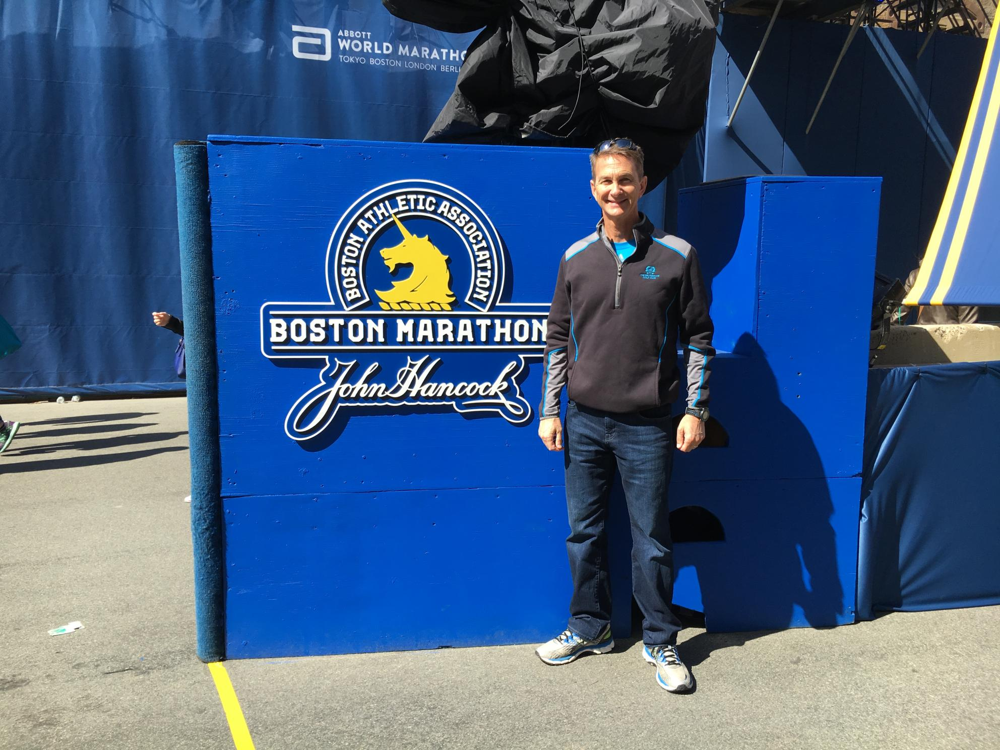 New CEO Eric Thornburg standing outdoors in street clothes at the Boston Marathon