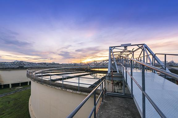 Outdoor shot of a water treatment tank at sunrise