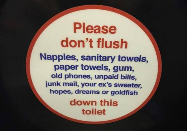 Please don't flush the following Sign